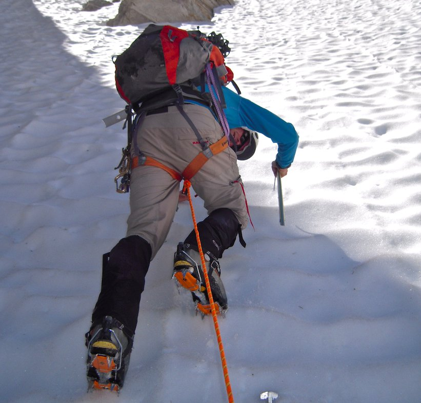 Snow climbing with crampons and ice axe