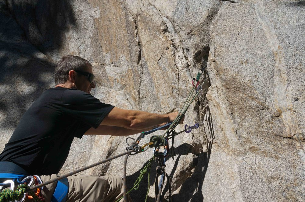 Building rock climbing anchors