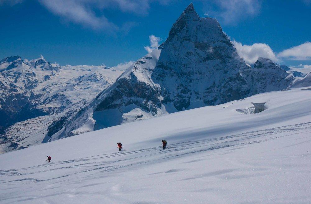 Skiing down a Swiss glacier past the Matterhorn