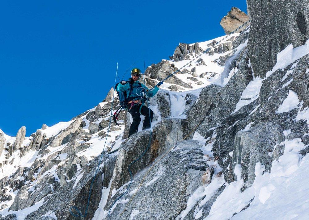 Rappelling into a ski line in Chamonix