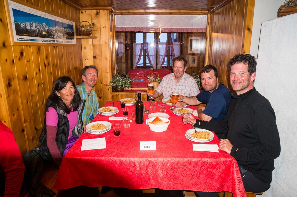 Enjoying a fine meal at the Branca hut on the Ortler ski tour in Italy