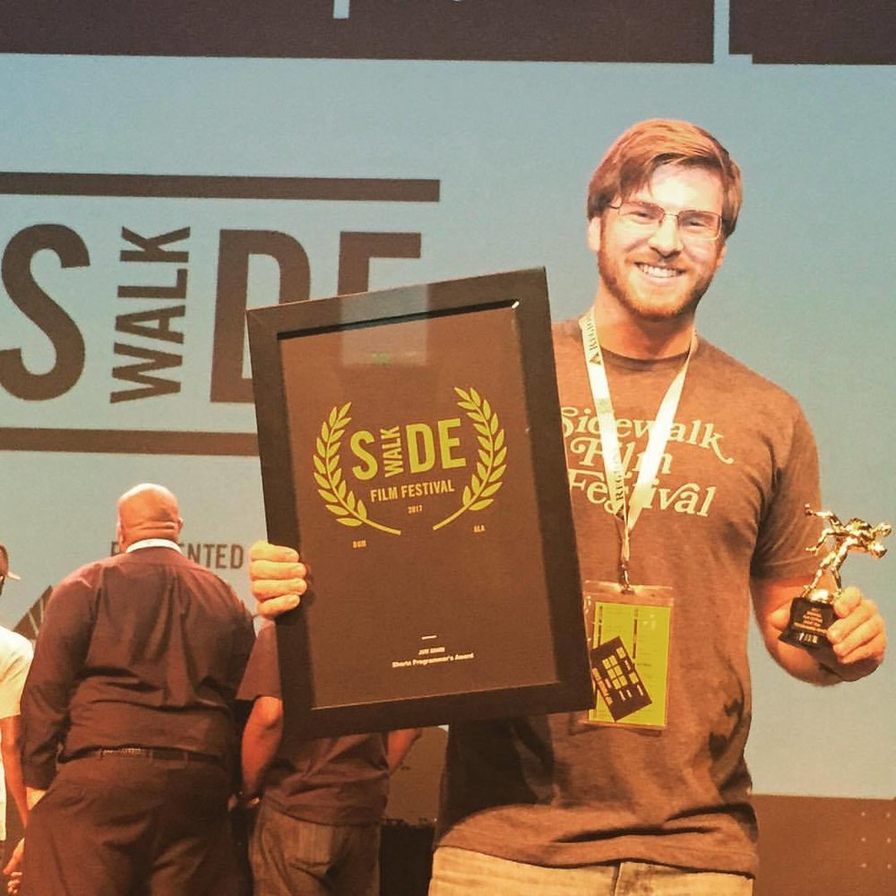 "(2017) Sidewalk Film Festival : Programmer's Award for ""Shilo"".   ""Thousands upon thousands of films are submitted to film festivals every year. To be selected into one, is incredibly difficult to do. I'm humbled to have been included in life changing film festivals where I've met some of my best friends & co-workers."" -Tyler"