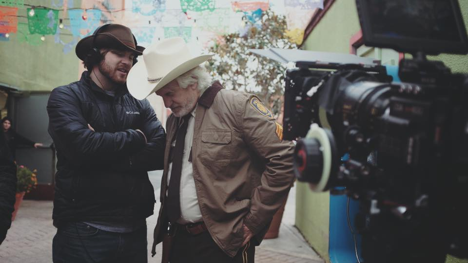 "George Hardy and Tyler Russell on the set of ""Texas Cotton""."