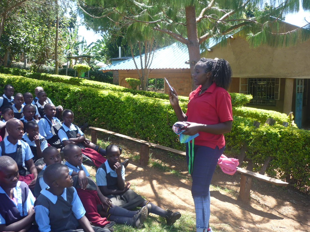 GSP Program Officer, Lonah Maiko providing education to girls at Precious Talent Academy
