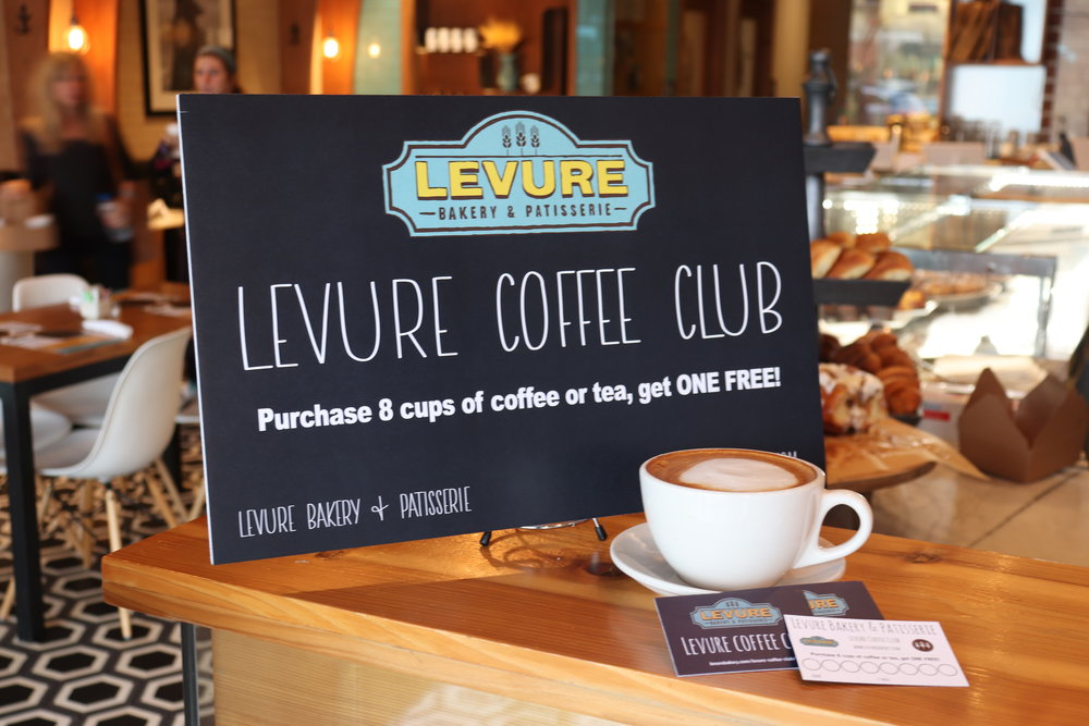 Get a Levure loyalty card, purchase 8 cups of coffee or tea, get ONE FREE - any locations