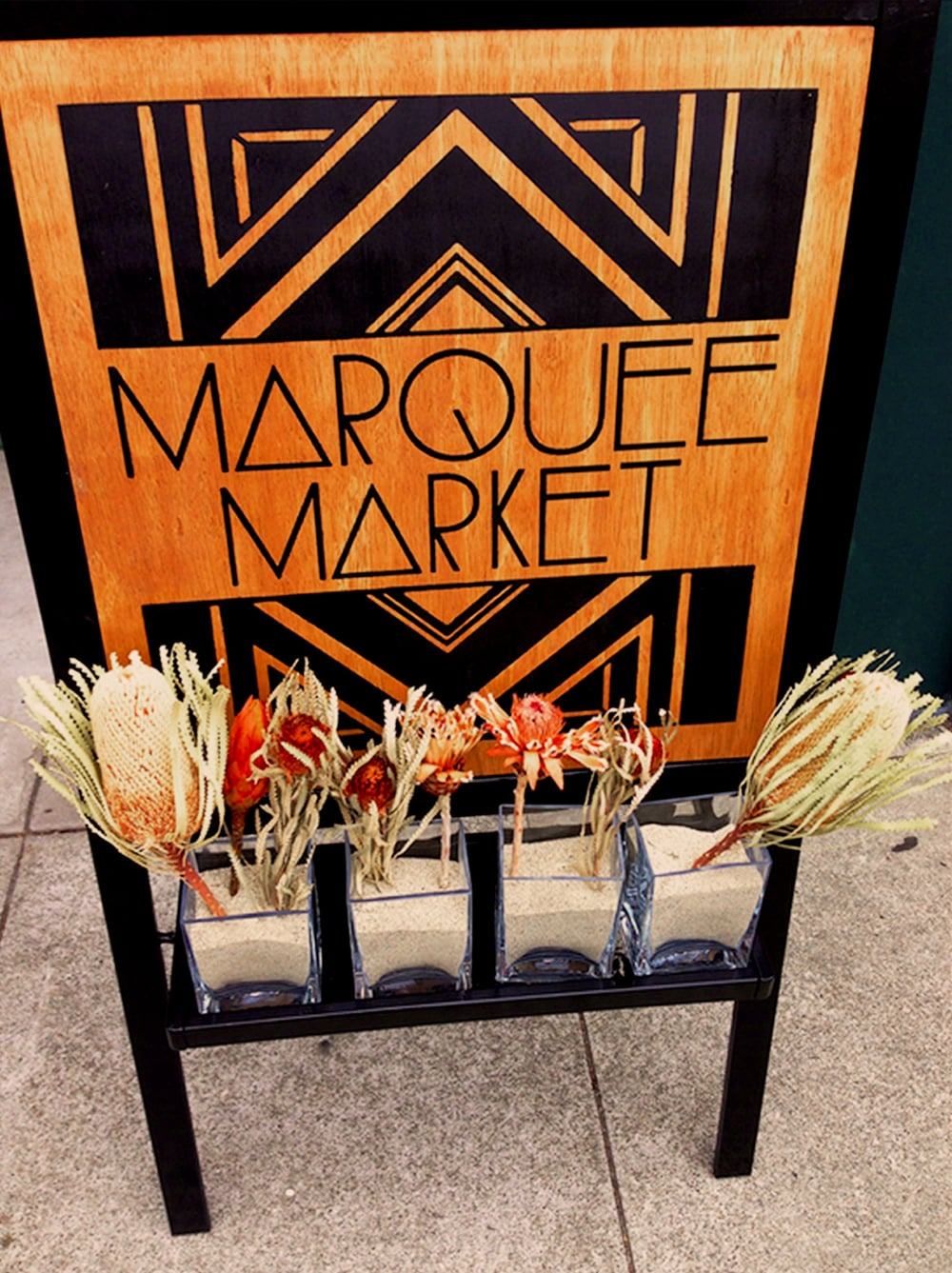 STARCADE DESIGNS & PRINT PRODUCTION FOR MARQUEE SALON / SCREEN-PRINTED DOUBLE-SIDED SIGNAGE FOR MARQUEE MARKET  .