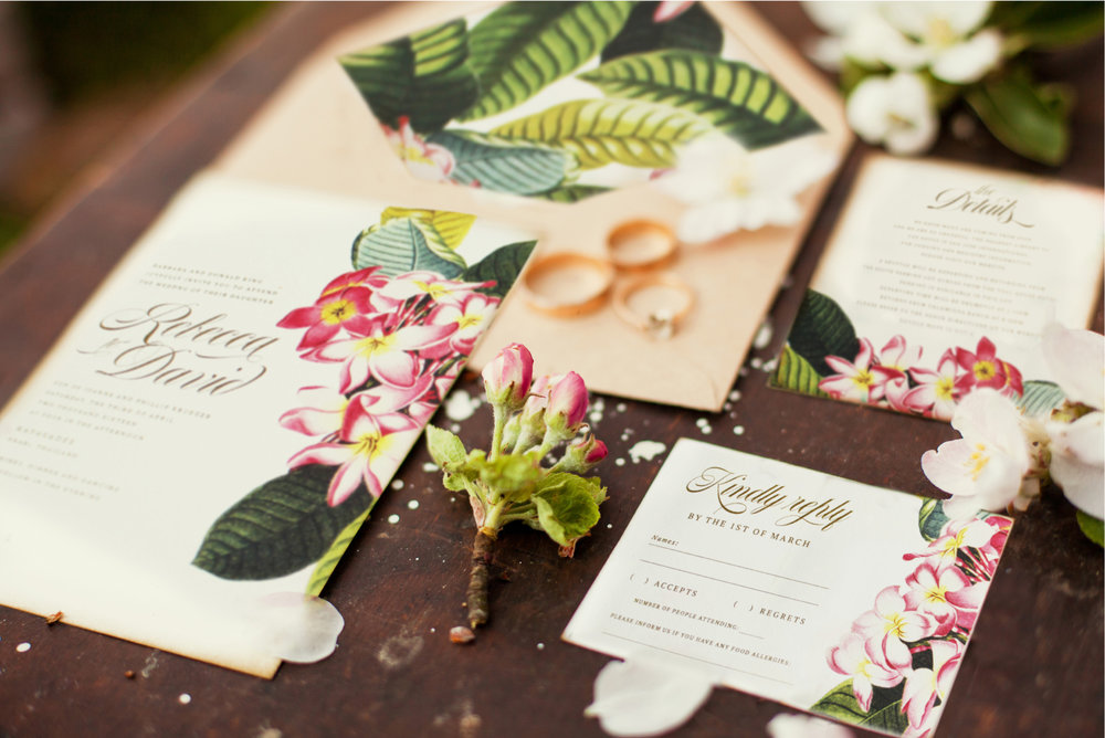 tropical-floral-plumeria-frangipani-flowers-wedding-invitation-banana-leaf-palm-leaves.jpg