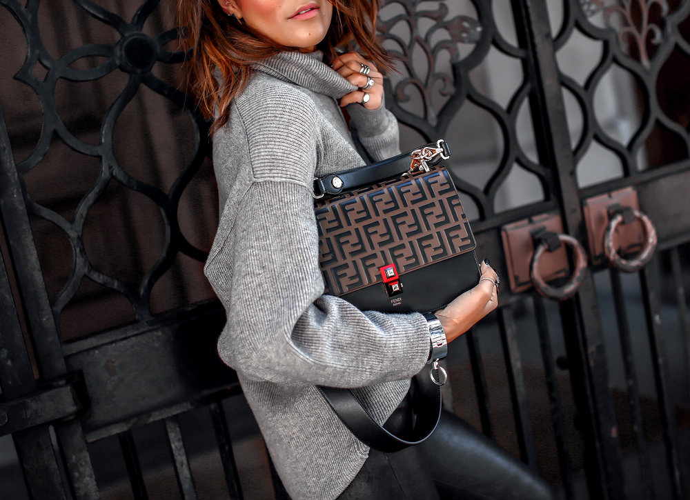 Brunette Woman Holding Handbag