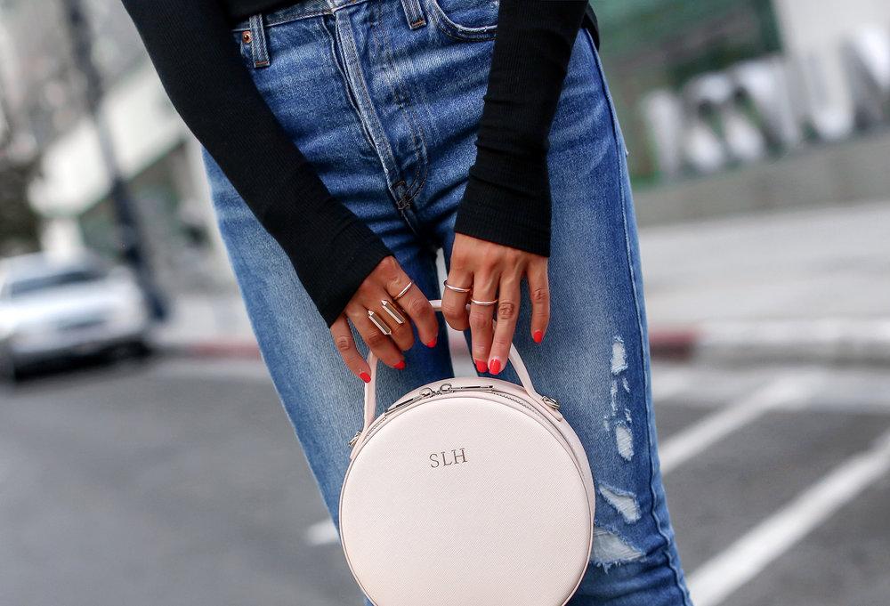 Woman Wearing Long Sleeve Henley Redone Blue Denim The Daily Edited Bag.jpg