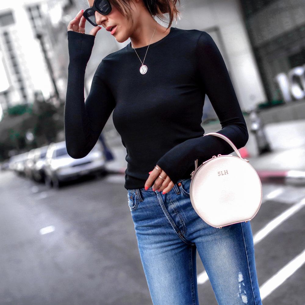 Brunette Woman Wearing Long Sleeve Henley Redone Blue Denim The Daily Edited Bag.jpg