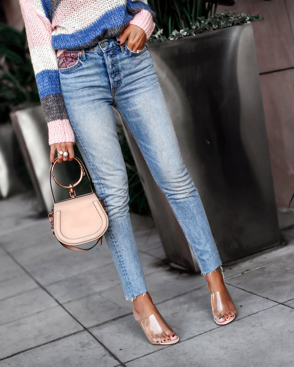 Brunette Woman Wearing Grlfrnd Denim and Plexi Sandals