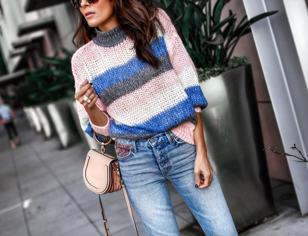 Brunette Woman In Stripped Sweater