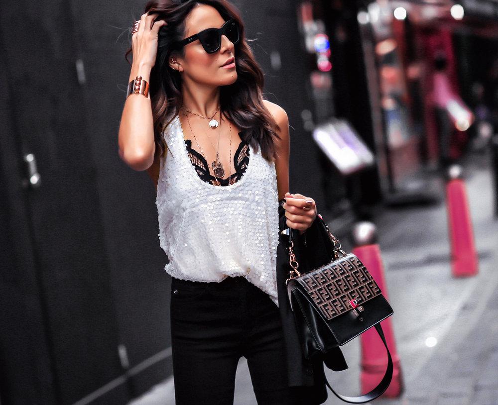 Brunette Woman In London Wearing Sequins Top Fendi Kan Bag