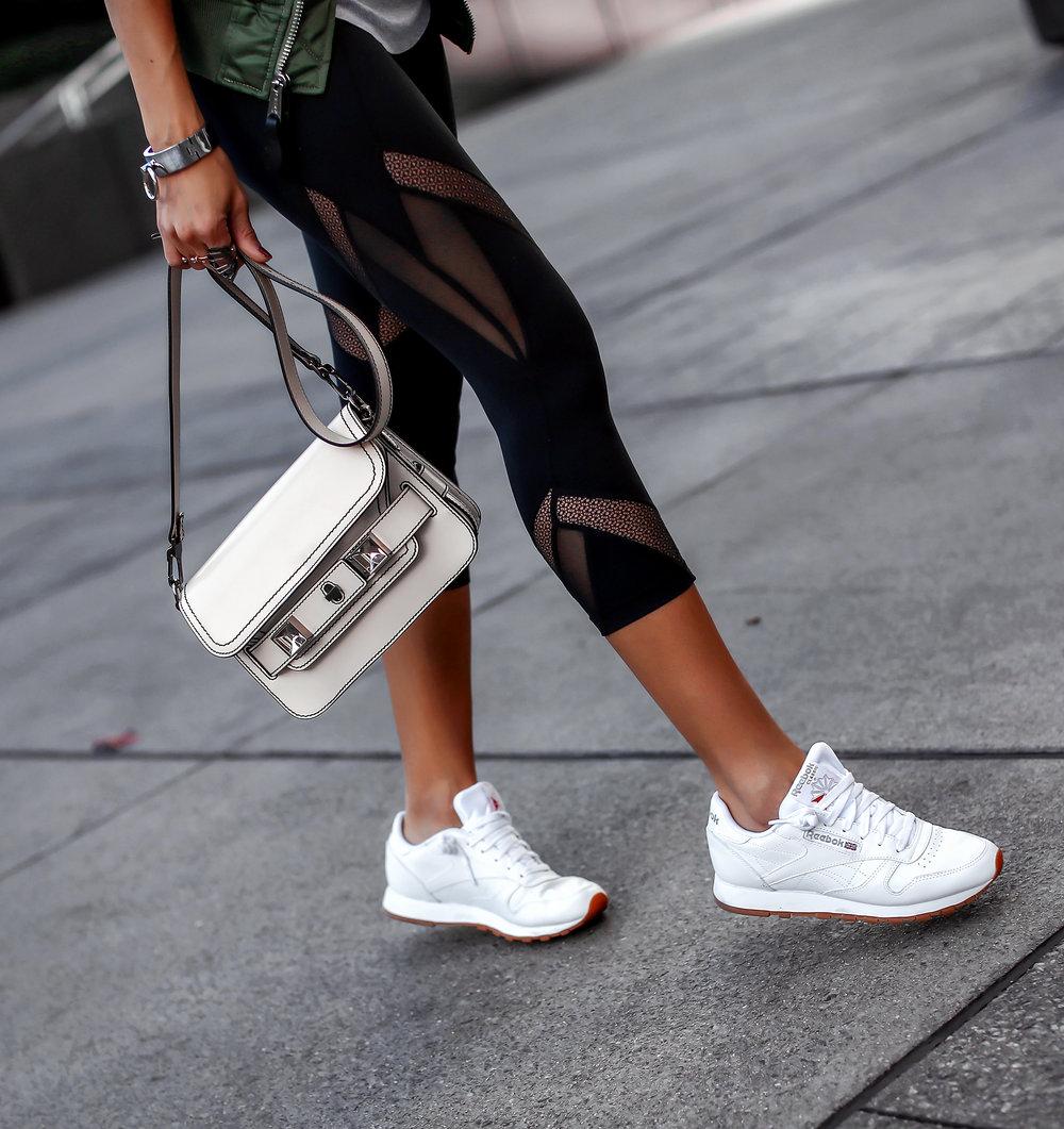 Woman Walking in Reebok Sneakers