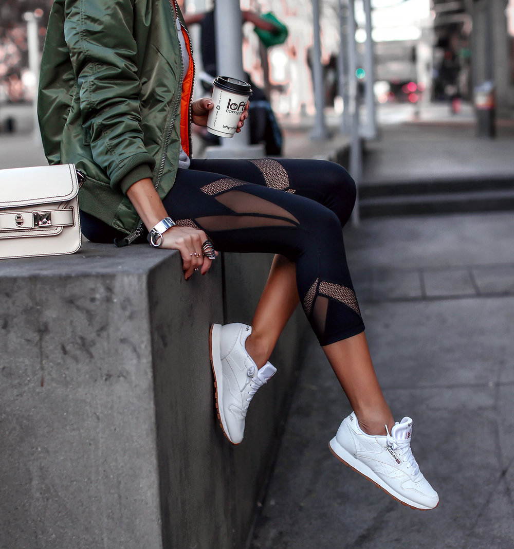Woman Sitting in Athletic wear