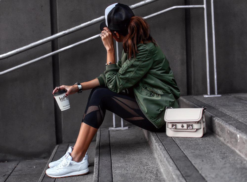 Brunette Woman Sitting in Athletic wear