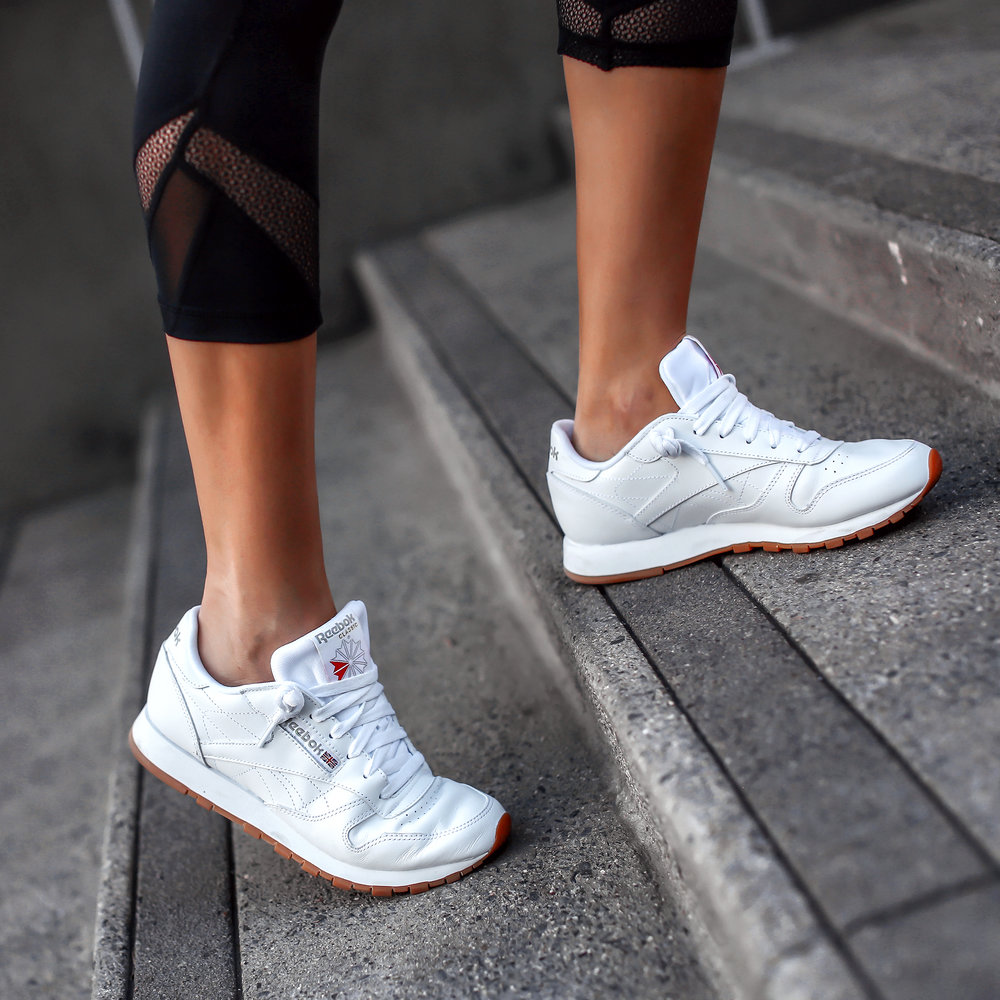 Woman Walking in Reebok Classic Sneakers