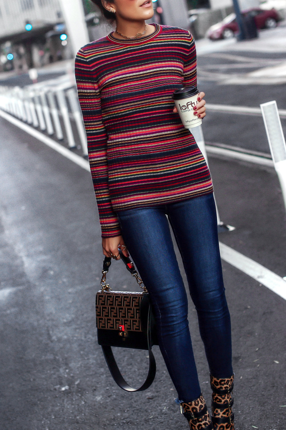 Brunette Woman Wearing Striped Knit Leopard Boots Fendi Kan Bag