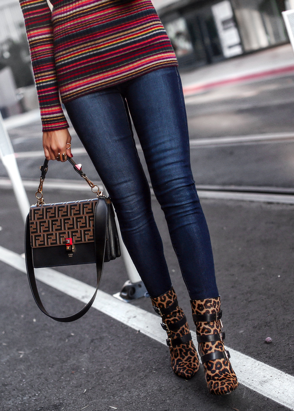 Woman Wearing Striped Knit Leopard Boots Fendi Kan Bag