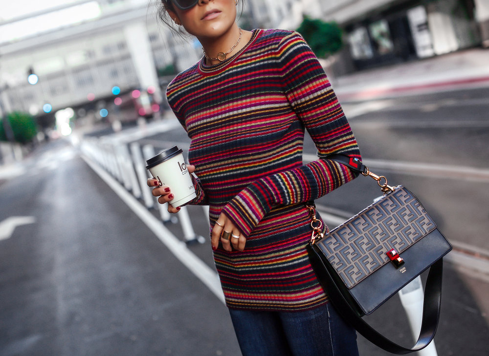 Brunette Woman Wearing Striped Knit Fendi Kan Bag