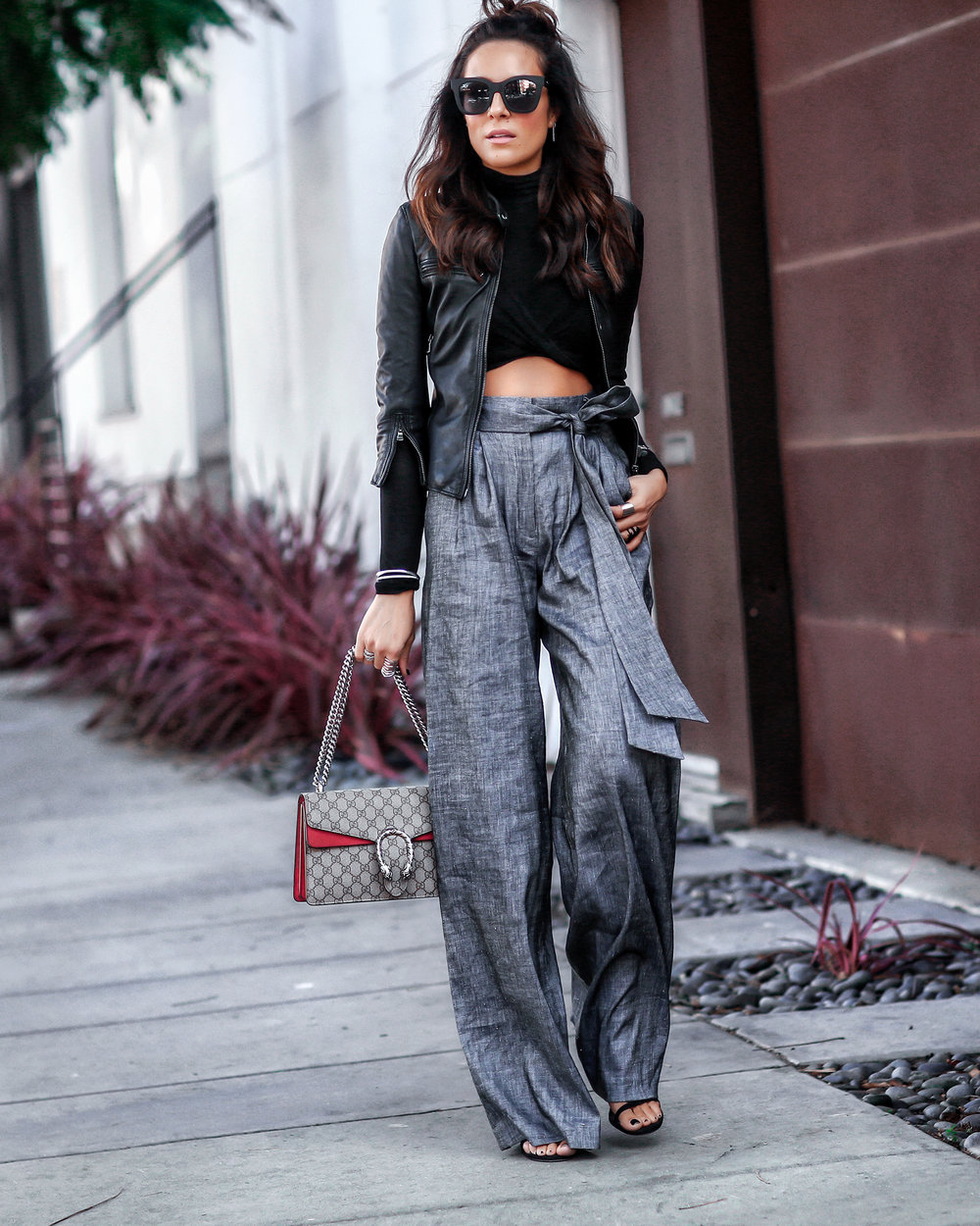 Brunette Woman in Crop Top and Wide Leg Pants Gucci Dionysus Bag