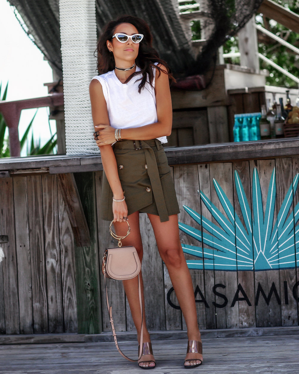 Brunette Woman in Army Green Miniskirt in the Bahamas