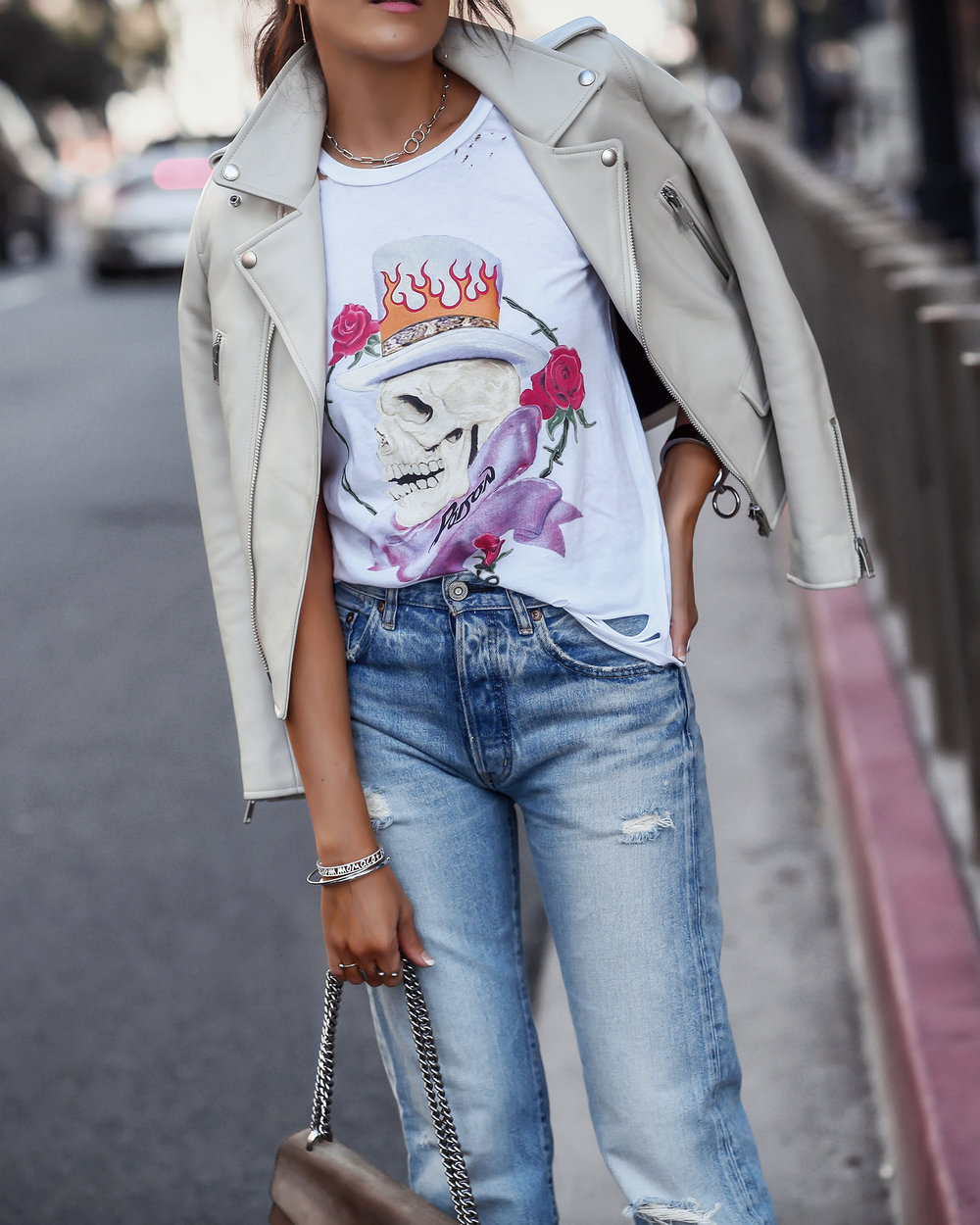 Detail Shot of Brunette Woman in Poison Tee and Moussy Denim