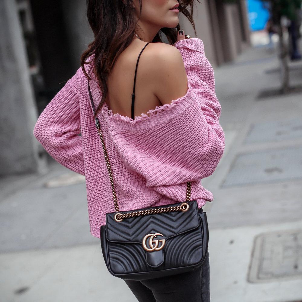 brunette woman in pastel pink sweater