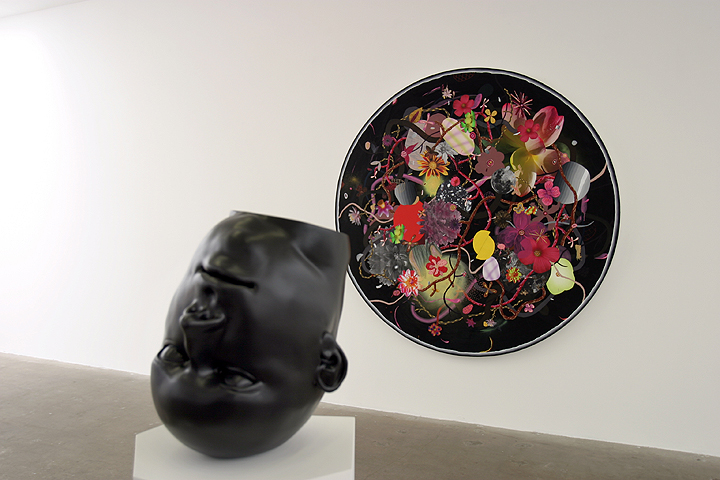 "Amir H. Fallah, ""Infinite Circles Around The Sun"", 2010 acrylic, pencil, collage, ink on paper mounted to canvas 72 inches diameter, Tanya Batura ""Monochroma J"", 2010 clay, acrylic 13 ¾ x 11 x 11 inches"