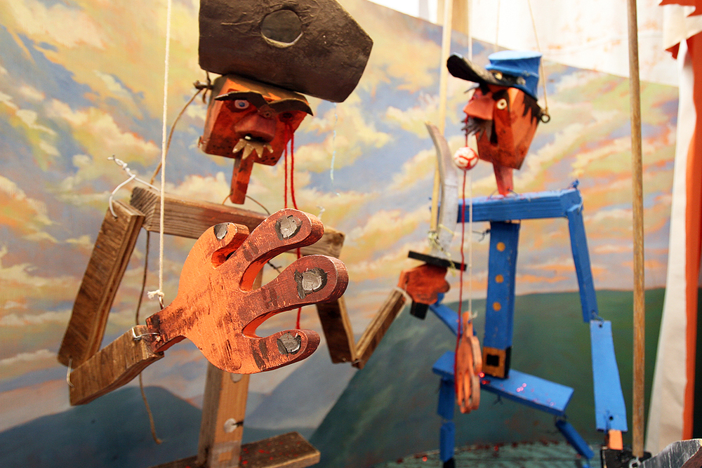 "Detail of ""Rebel vs. Yankee"" puppet show at Wayne White's ""Sand Mountain Tractor"" 2011 exhibition at Western Project"
