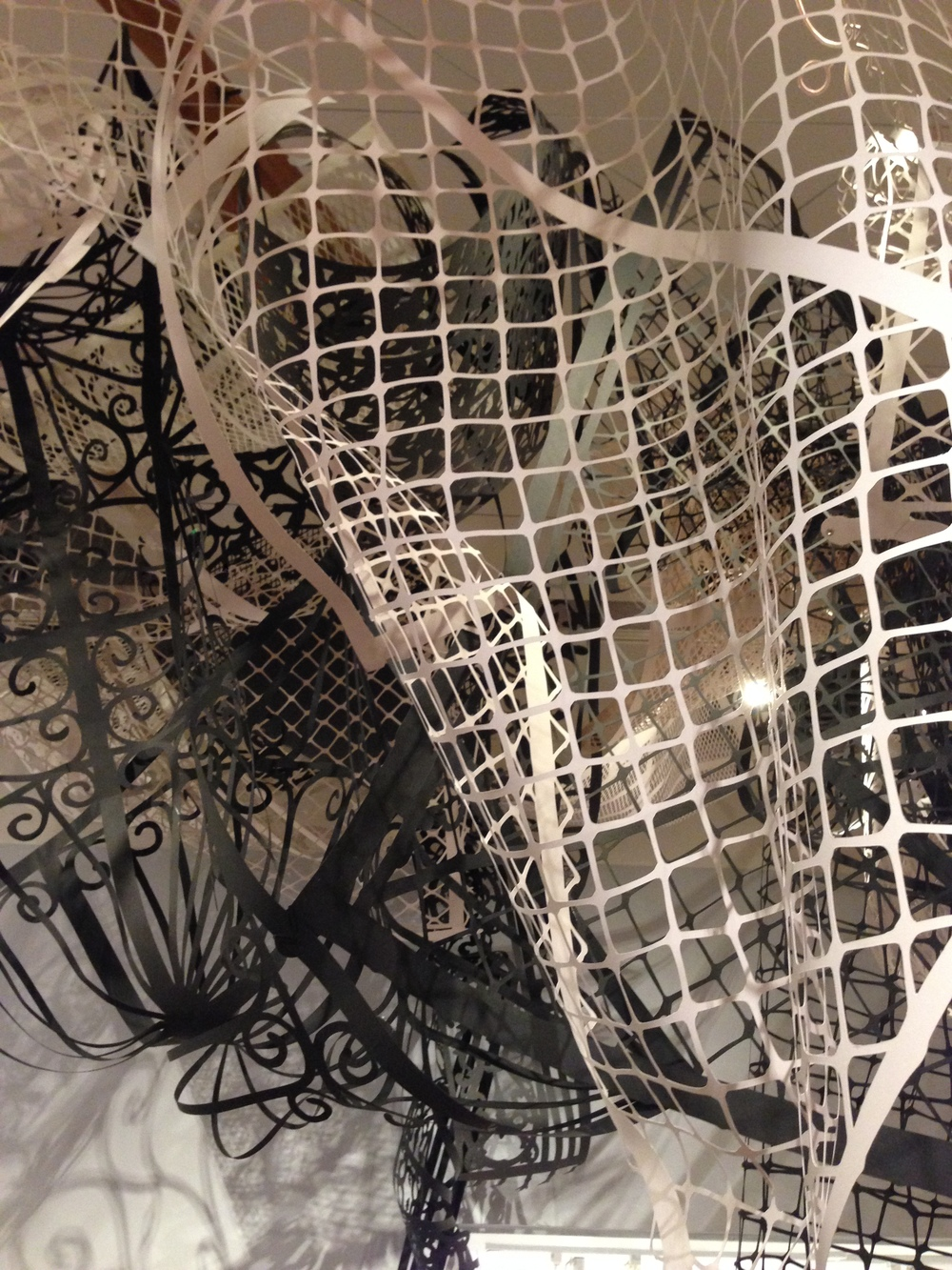 MARGARET GRIFFITH, Commonwealth, 2015, installation at the Craft and Folk Art Museum, hand cut paper, dimensions variable.