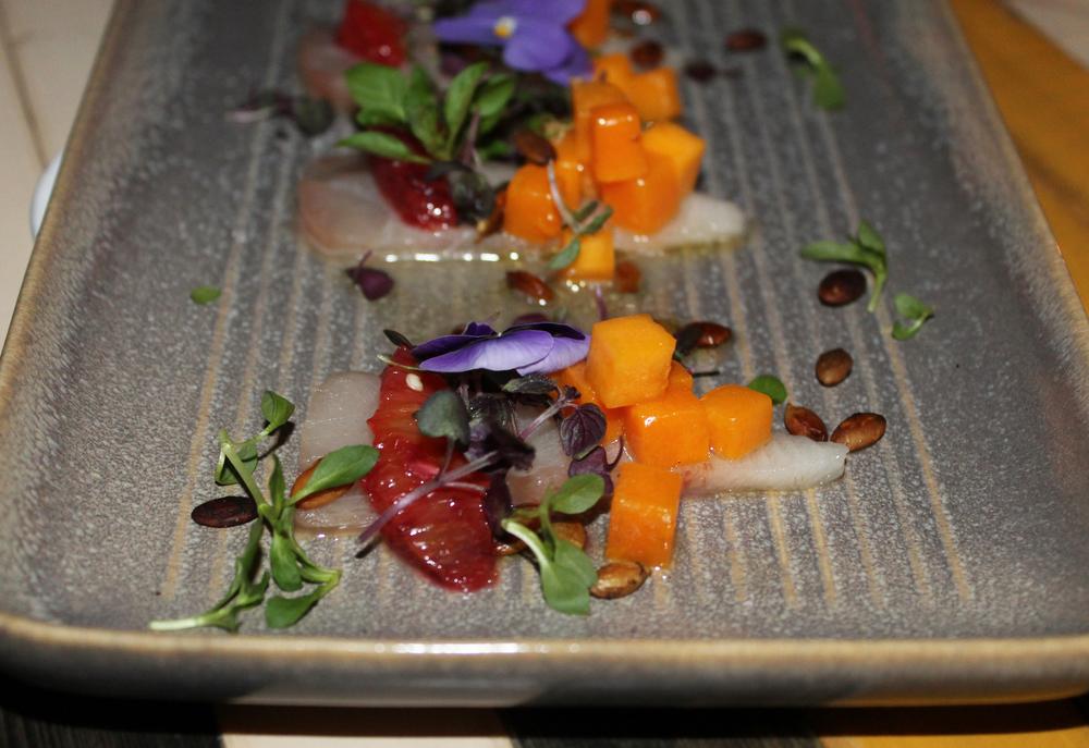 Hamachi Crudo: Confit squash, citrus, thai chile, truffled pumpkin seeds