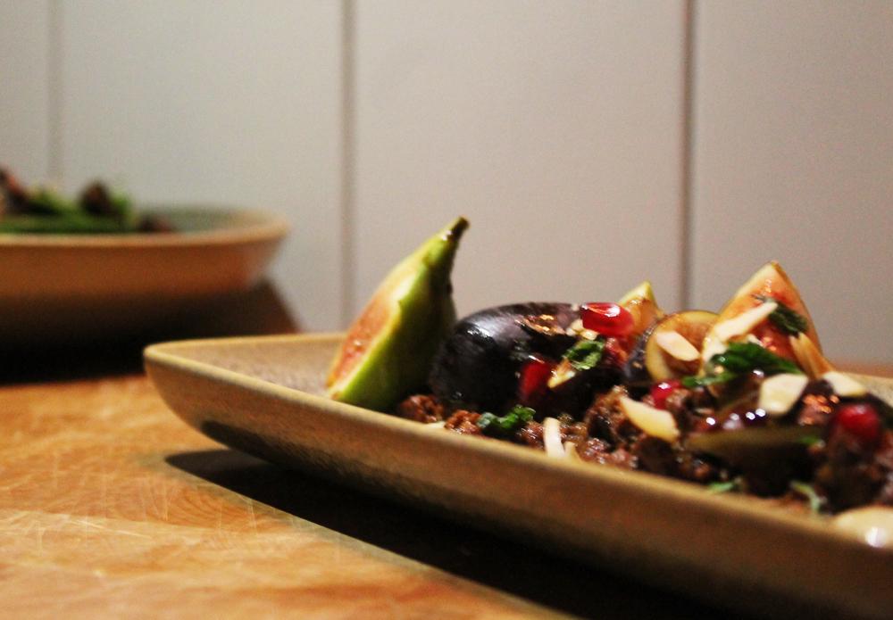 Sliced Figs:Turkey chorizo, pomegranates, mint, raw almonds.