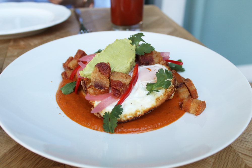 CRISPY PORK BELLY: Fried Eggs, Pickled Onions, Spicy Tomato Sauce