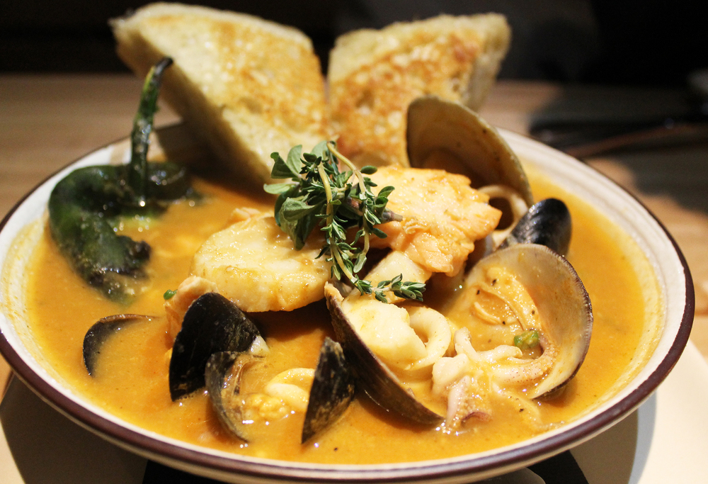 Chile Relleno de Siete Mares : poblano chile, shrimp, scallops, mussels, fish, clams, calamari, tomato-chile broth, ciabatta