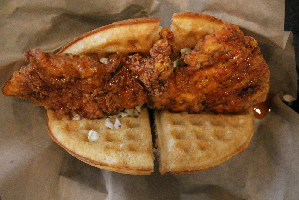 BUTTERMILK FRIED CHICKEN AND WAFFLE SANDWICH:  Seasoned Fried Chicken Breast, Chili Honey, Cider Slaw