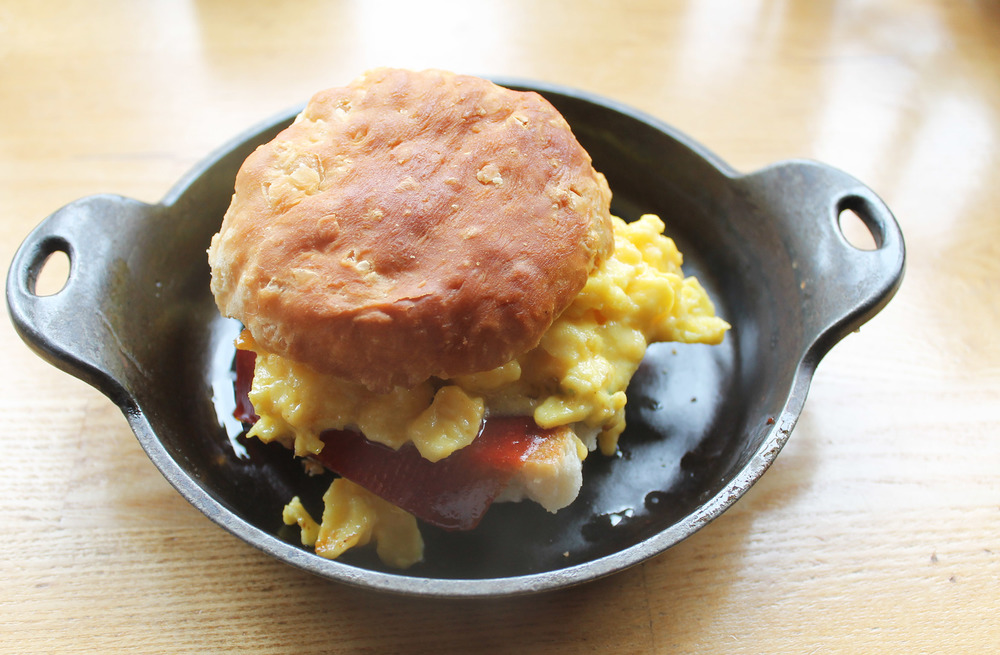 PLAN CHECK EGG SANDWICH:    buttermilk biscuit, cheesy scramble, bacon, KETCHUP LEATHER