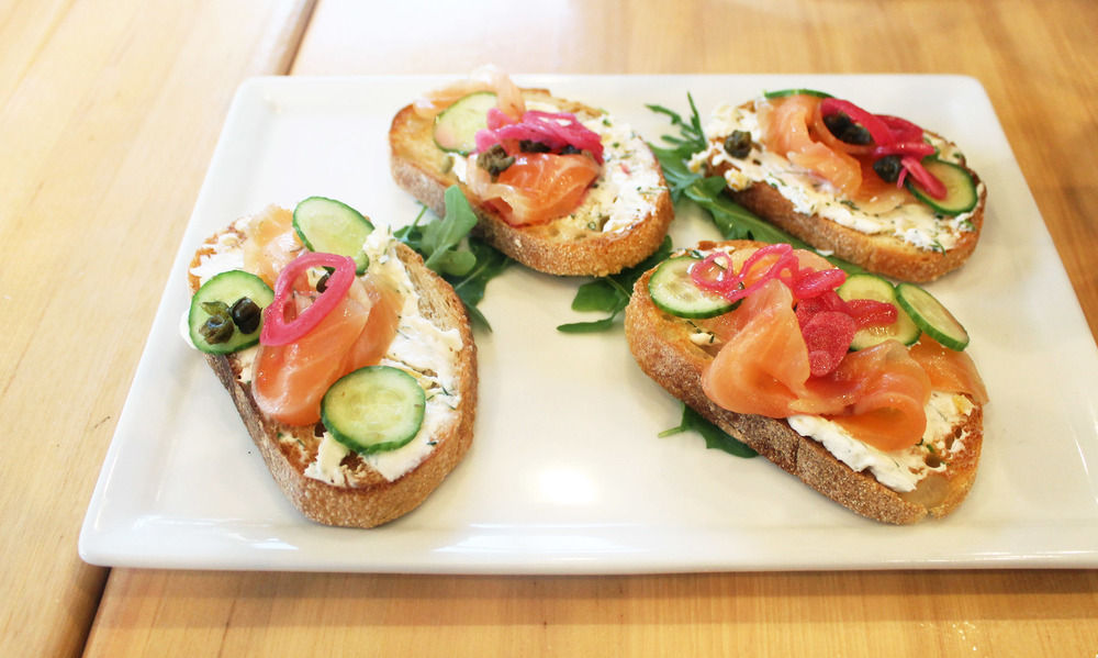 House Cured Lox on Toast : preserved lemon cream cheese, pickled shallots, cucumber and capers