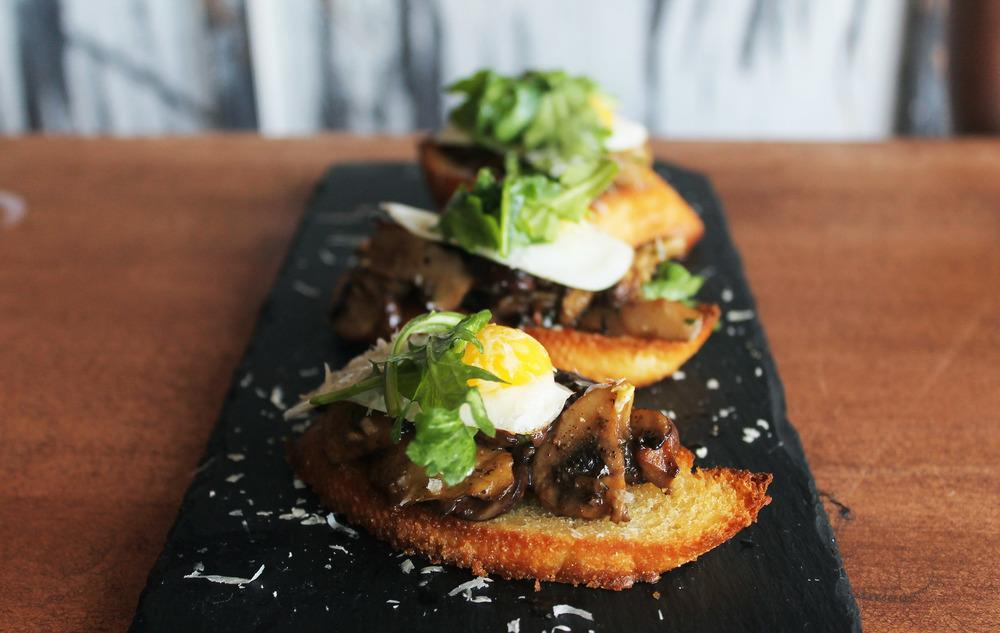Wild Mushroom Bruschetta: Crimini & Oyster Mushrooms, White Wine, Herbs, Quail Egg, Crostini