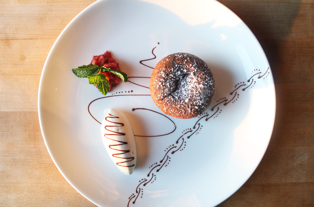 VALRHONA CHOCOLATE CAKE:Rhubarb compote, elderflower Chantilly