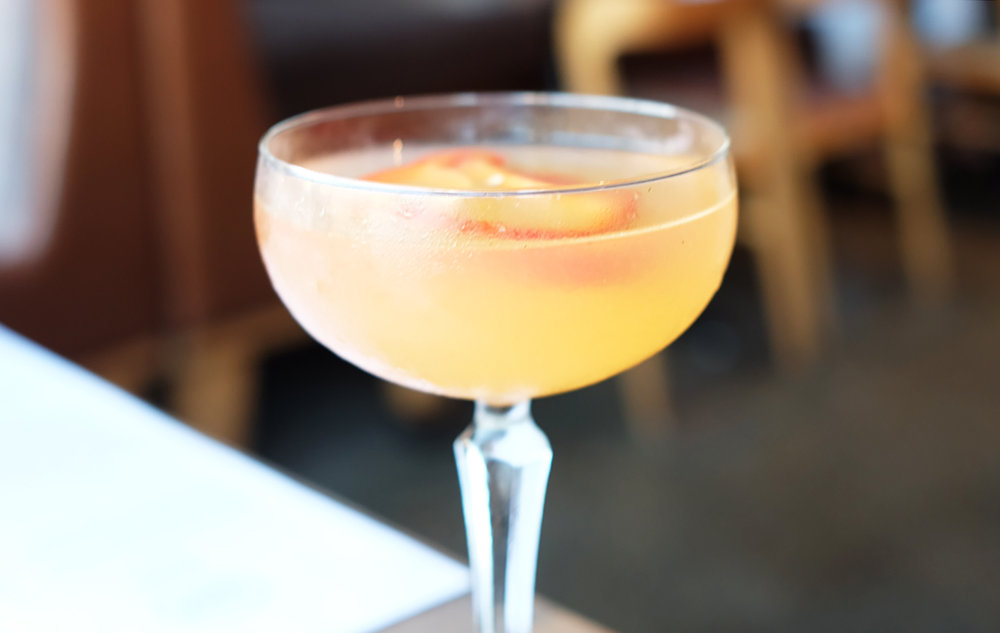LADY IN THE BALLROOM: Grapefruit vodka, st germain, red bell pepper, mint, lemon juice
