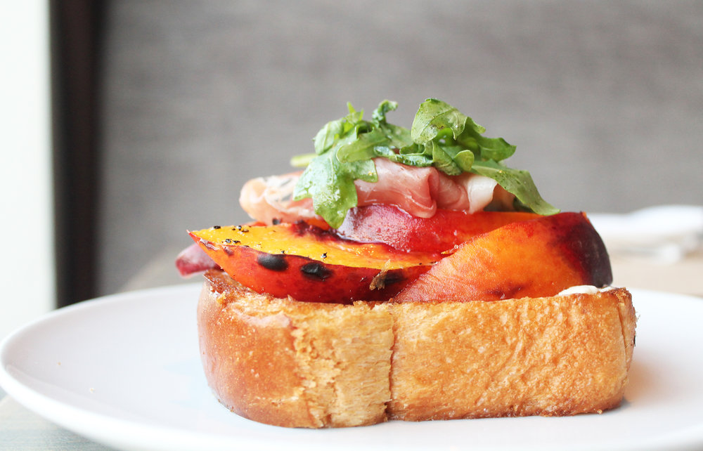 WOOD OVEN ROASTED LOCAL PEACHES: toasted brioche, prosciutto, la tur triple cream