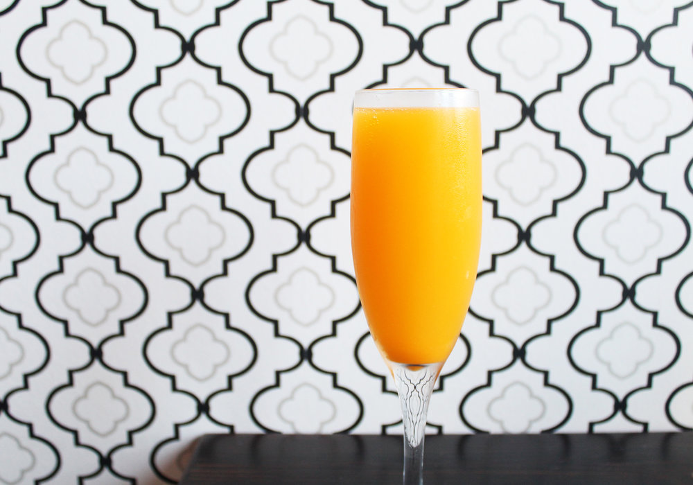 Tang Mimosa: Bubbles, House-Made Tang syrup, hand crafted orange curacao