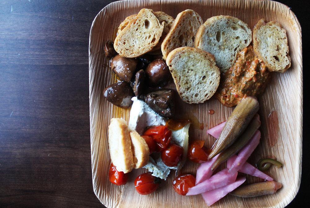 Condimenti Platter: Labneh, Red Pepper Romesco, Tomato Confit, Pickled Vegetables, Marinated Mushrooms, Crostini