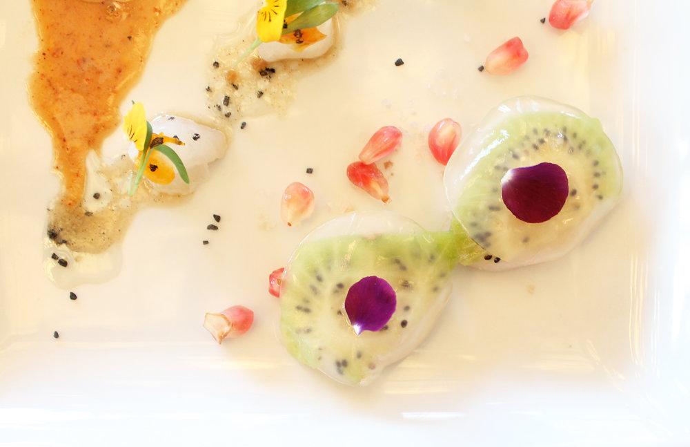 Hokkaido Scallops, Compressed Kiwi, Yuzu Jelly, Smoked Maldon Salt, and White Pomegranate