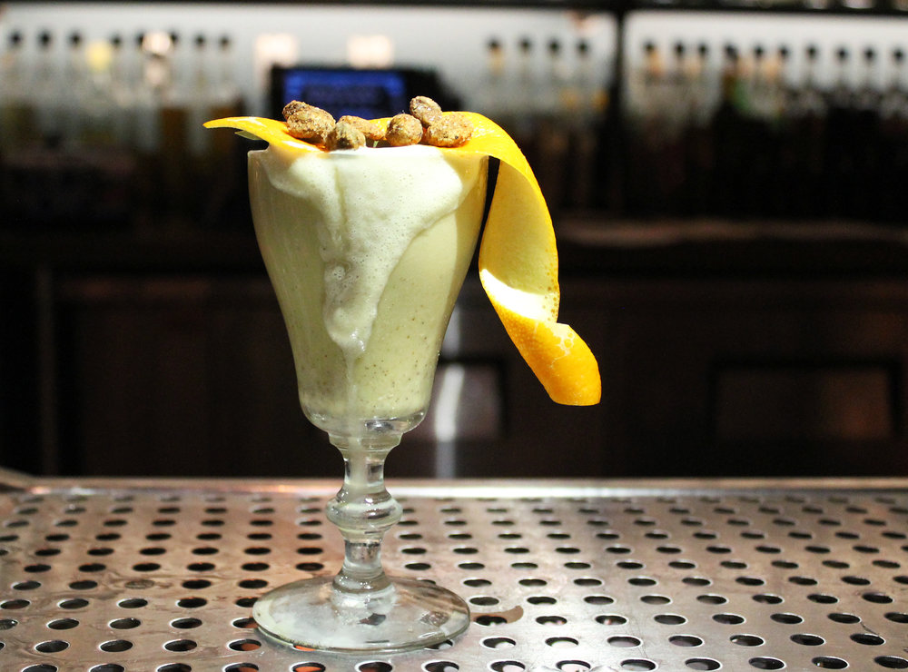 PISTACHE FIZZ : Old tom gin, Park VSOP, lemon juice, honey, pistachio butter, egg white, soda water