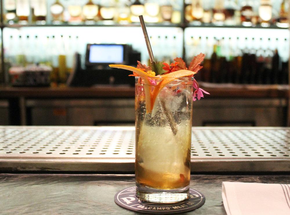 BELCAMPO SPRITZ :Amber vermouth, St~Germain, amontillado sherry, sparkling wine, soda water