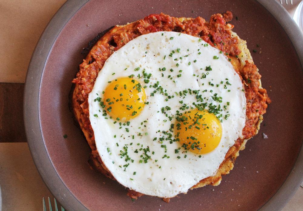 Waffle, beef and pork bolognese, sunnyside egg