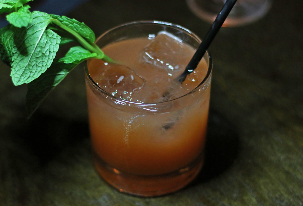 The Billboard: a whisky smash that uses Virginia Black, muddled strawberries, and housemade honey syrup