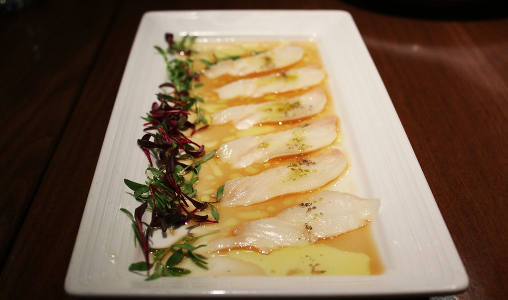 Halibut Carpaccio: local halibut, citrus juice, olive oil, sea salt, yuzu kosho, shiso basil.